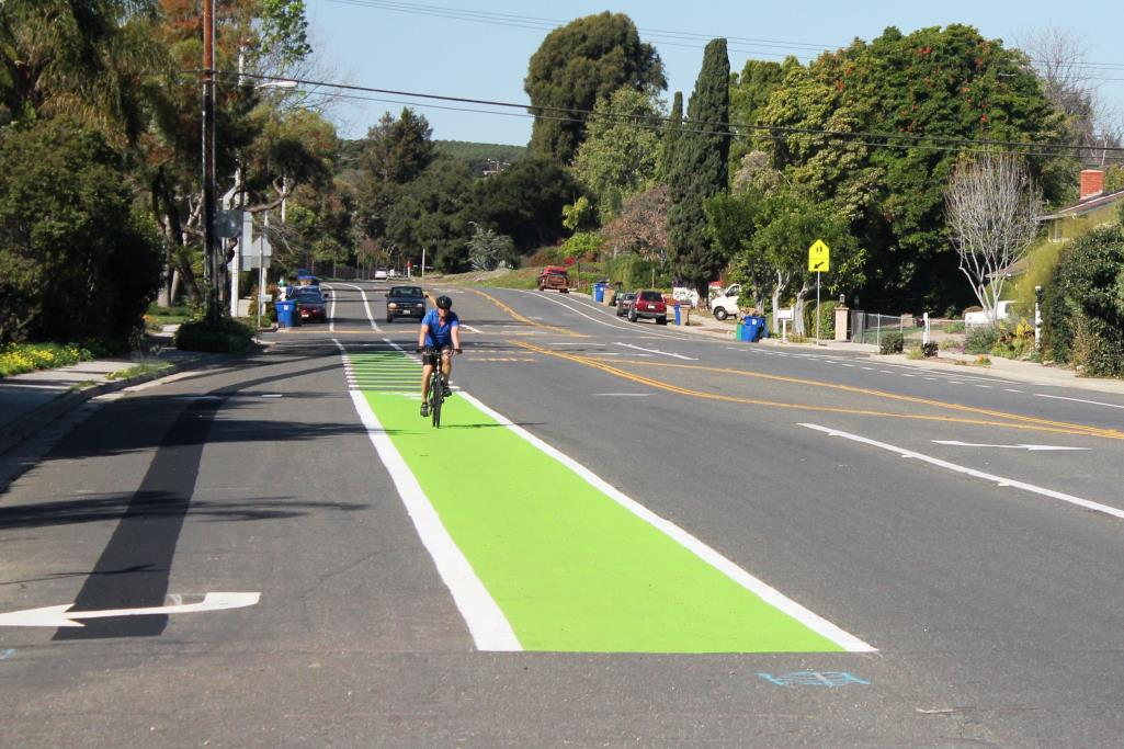 "Class II facilities designates an on-road bicycle lane. Width and other characteristics can vary. Class II bike lanes are typically 5-6′ wide. These standard bike lanes can also include a painted ""buffer"" of 2-4′."