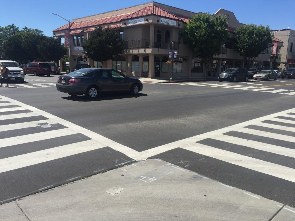 High visibility crosswalks are ladder style crosswalks at intersection and midblock crossing locations. They guide pedestrians and alert drivers to a crossing location.